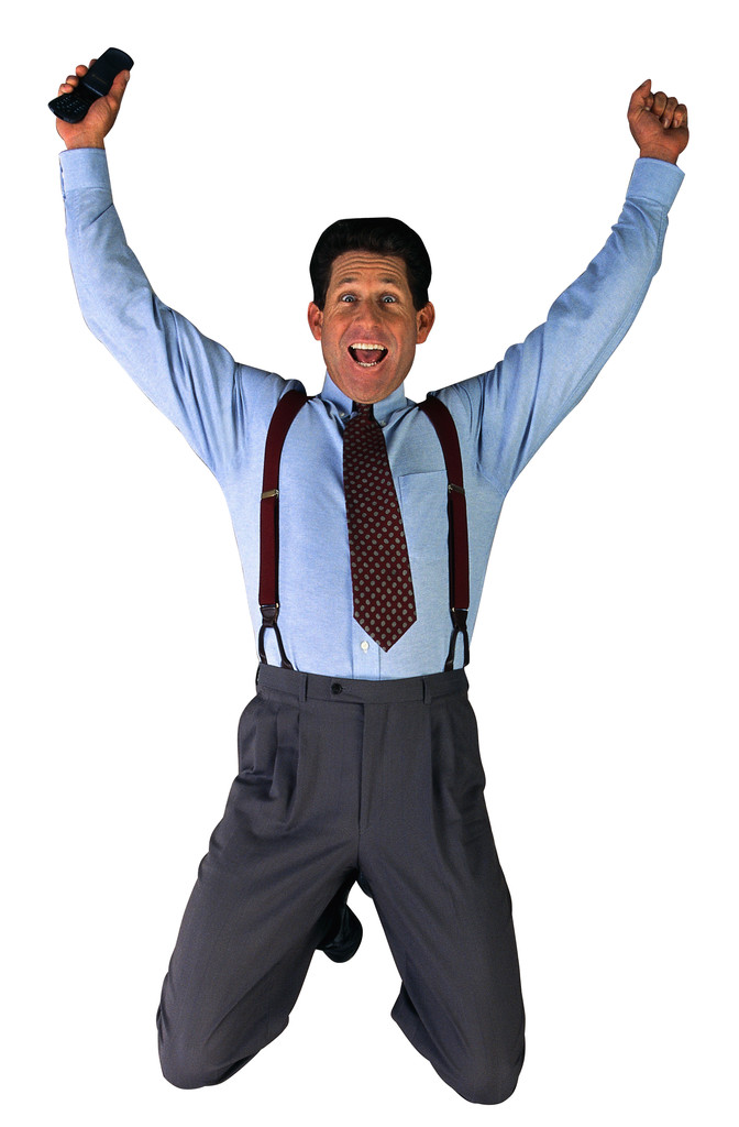 Businessman with Cell Phone Jumping